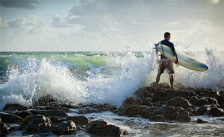 Surfer Standing on Rocks with Rough Seas Stock Photo - Rights-Managed, Code: 700-05947674