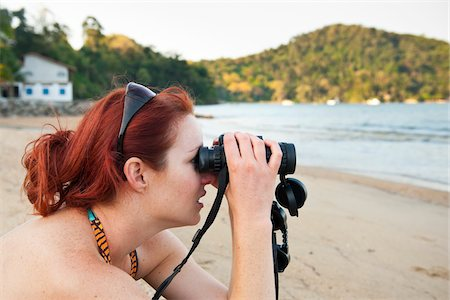 Woman with Binoculars on Beach, near Paraty, Costa Verde, Rio de Janeiro, Brazil Stock Photo - Rights-Managed, Code: 700-05947860