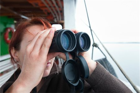Woman on Boat with Binoculars Stock Photo - Rights-Managed, Code: 700-05947861