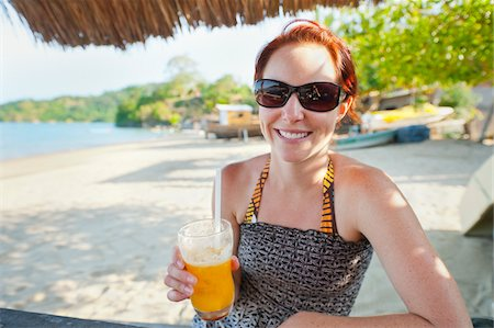 Woman with Mango Drink on Beach, near Paraty, Rio de Janeiro, Brazil Stock Photo - Rights-Managed, Code: 700-05947863