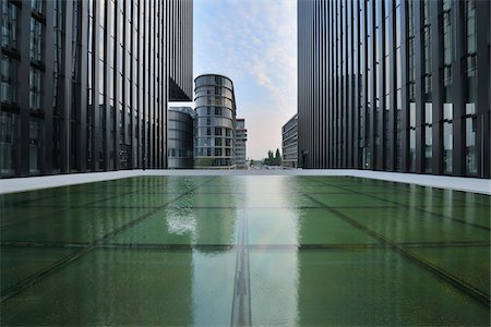 Water Feature in Front of Building, Media Harbour, Dusseldorf, North Rhine Westphalia, Germany Stock Photo - Rights-Managed, Code: 700-05948158