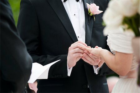Bride and Groom Exchanging Rings during Wedding Ceremony Stock Photo - Rights-Managed, Code: 700-05948283