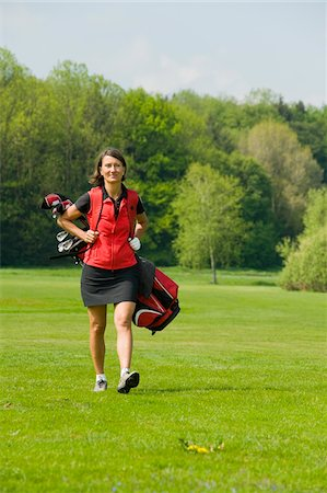 Woman Carrying Golf Bag Stock Photo - Rights-Managed, Code: 700-05969957