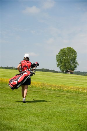 Woman Carrying Golf Bag Stock Photo - Rights-Managed, Code: 700-05969966