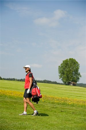 Woman Carrying Golf Bag Stock Photo - Rights-Managed, Code: 700-05969967