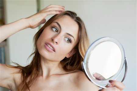 Woman Looking at Self in Mirror Stock Photo - Rights-Managed, Code: 700-05974054