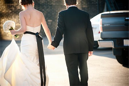 person walking on parking lot - Bride and Groom Holding Hands Stock Photo - Rights-Managed, Code: 700-05974132