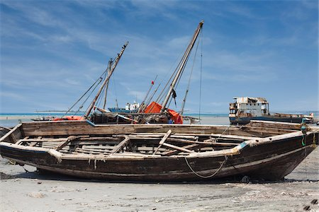 Fishing Boat at Low Tide, Stone Town, Zanzibar, United Republic of Tanzania Stock Photo - Rights-Managed, Code: 700-05973262