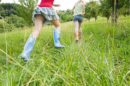 rear - Two Girls Running in Field Stock Photo - Rights-Managed, Code: 700-05973436