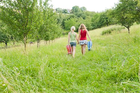 rear - Two Girls Walking in Field Stock Photo - Rights-Managed, Code: 700-05973438