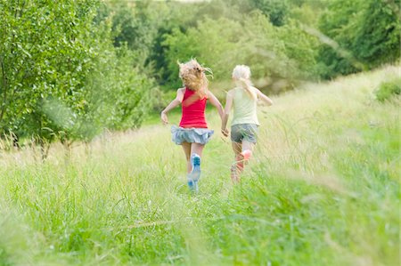 rear - Two Girls Running in Field Stock Photo - Rights-Managed, Code: 700-05973441