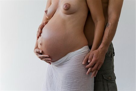 expectation - Pregnant Couple in Studio Stock Photo - Rights-Managed, Code: 700-05973492