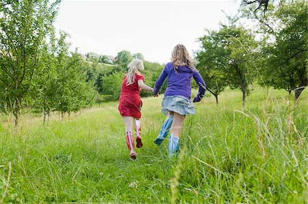 family shoes - Two Girls Running in Field Stock Photo - Rights-Managed, Code: 700-05973507