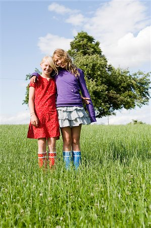 Portrait of Two Girls Standing in Field Stock Photo - Rights-Managed, Code: 700-05973516