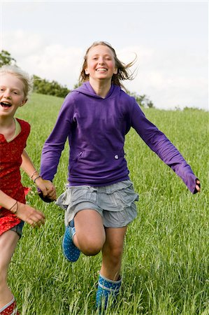Two Girls Running in Field Stock Photo - Rights-Managed, Code: 700-05973512