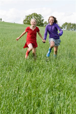 family shoes - Two Girls Running in Field Stock Photo - Rights-Managed, Code: 700-05973513
