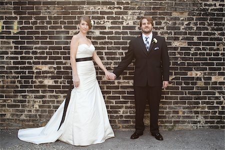 summer - Bride and Groom Standing in front of Brick Wall Stock Photo - Rights-Managed, Code: 700-05973638