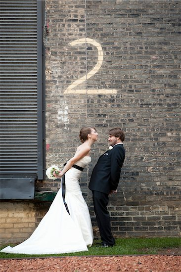 Bride and Groom with Number Two Painted on Brick Wall Stock Photo - Premium Rights-Managed, Artist: Ikonica, Image code: 700-05973651