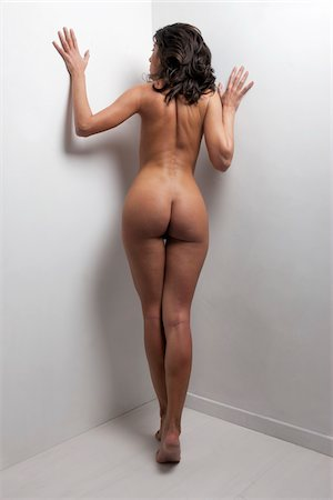 Nude Woman Standing in Corner of Room Stock Photo - Rights-Managed, Code: 700-05973906