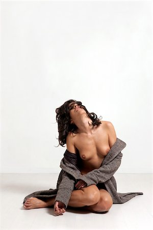 Nude Woman Sitting on Studio Floor Stock Photo - Rights-Managed, Code: 700-05973908