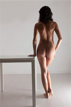 Nude Woman Standing next to Table Stock Photo - Rights-Managed, Code: 700-05973909