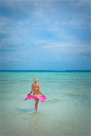 Woman on Wading in Ocean, Krabi, Thailand Stock Photo - Rights-Managed, Code: 700-05973930