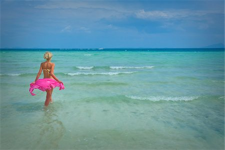 Woman on Wading in Ocean, Krabi, Thailand Stock Photo - Rights-Managed, Code: 700-05973931