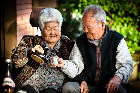 Elderly Couple Drinking Tea, Isen, Tokunoshima Island, Kagoshima Prefecture, Japan Stock Photo - Rights-Managed, Code: 700-05973994