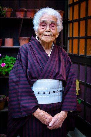 Portrait of Elderly Woman, Yo Village, Akari Towni, Amami Oshima, Amami Islands, Kagoshima Prefecture, Japan Stock Photo - Rights-Managed, Code: 700-05973991