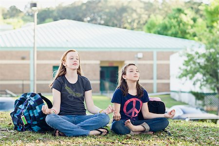 Two Teenage Girls Meditating on School Grounds Stock Photo - Rights-Managed, Code: 700-06009196