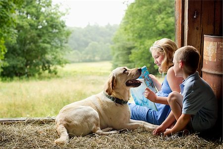 supervising - Children Reading in Barn with Dog Stock Photo - Rights-Managed, Code: 700-06009231