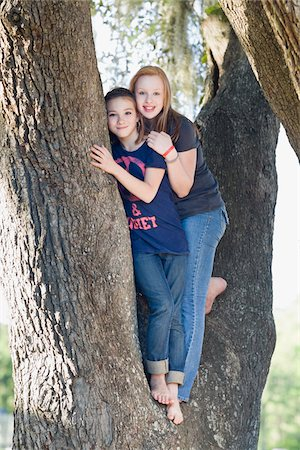 preteen touch - Two Teenage Girls Hugging in Tree Stock Photo - Rights-Managed, Code: 700-06119527