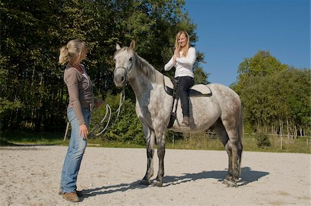 Woman Learning to Ride Horse Stock Photo - Rights-Managed, Code: 700-06119567