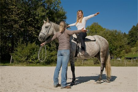 Woman Learning to Ride Horse Stock Photo - Rights-Managed, Code: 700-06119568