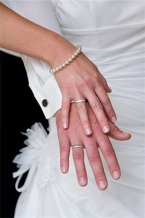 ring hand woman - Close-Up of Bride and Groom's Hands Stock Photo - Rights-Managed, Code: 700-06119574