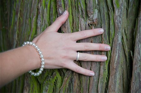 ring hand woman - Bride with Hand on Tree Trunk Stock Photo - Rights-Managed, Code: 700-06119577
