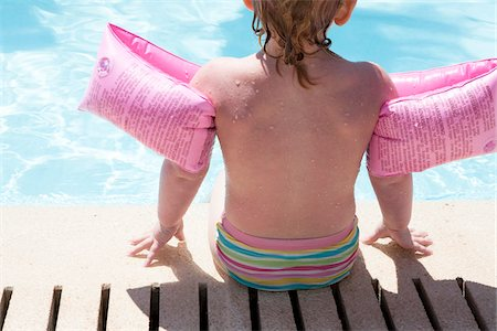 Little Girl Sitting Poolside Stock Photo - Rights-Managed, Code: 700-06119647