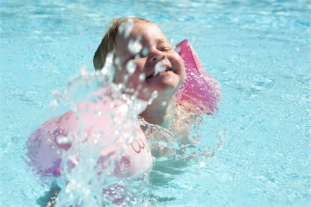 Little Girl Wearing Water Wings in Swimming Pool Stock Photo - Rights-Managed, Code: 700-06119649