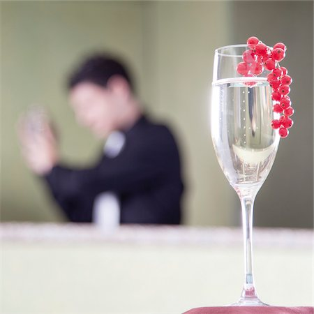 Glass of Prosecco with Red Currants on Bar Stock Photo - Rights-Managed, Code: 700-06119652