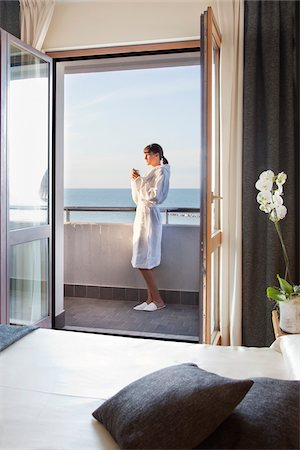 female only - Woman Having Morning Coffee on Balcony Stock Photo - Rights-Managed, Code: 700-06119744