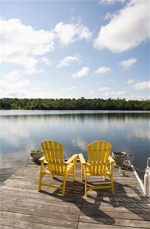 Yellow Chairs on Dock, Bobcaygeon, Ontario, Canada Stock Photo - Rights-Managed, Code: 700-06125703