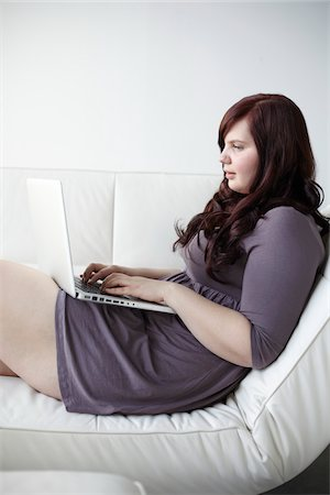 fat lady sitting - Woman Using Laptop Stock Photo - Rights-Managed, Code: 700-06144787