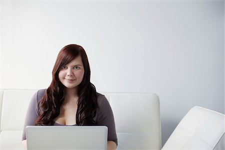 fat lady sitting - Woman with Laptop Stock Photo - Rights-Managed, Code: 700-06144789