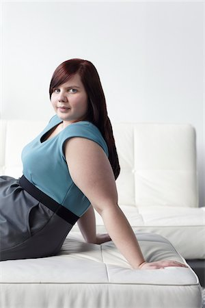 fat lady sitting - Portrait of Woman Sitting on Ottoman Stock Photo - Rights-Managed, Code: 700-06144797