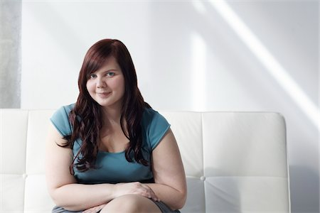 fat lady sitting - Portrait of Woman Sitting on Sofa Stock Photo - Rights-Managed, Code: 700-06144799