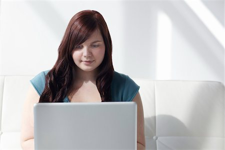 fat lady sitting - Woman Using Laptop Stock Photo - Rights-Managed, Code: 700-06144800