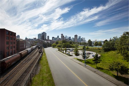 Road and Traintracks with Vancouver Skyline, Vancouver, British Columbia, Canada Stock Photo - Rights-Managed, Code: 700-06144876