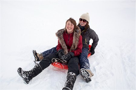 Teenage Girls Tobogganing Stock Photo - Rights-Managed, Code: 700-06145051
