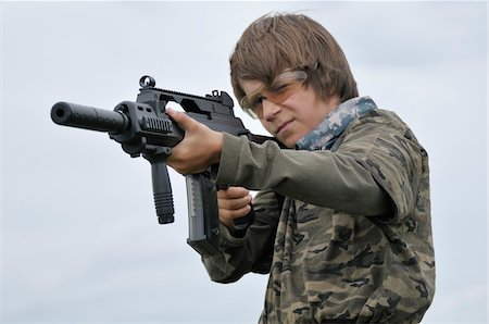 Boy Aiming Gun Stock Photo - Rights-Managed, Code: 700-06170358