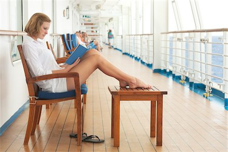 Teenage Girl Reading Book on Cruise Ship Stock Photo - Rights-Managed, Code: 700-06190526